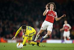 BATE Borisov's Slobodan Simovic (left) and Arsenal's Matteo Guendouzi battle for the ball