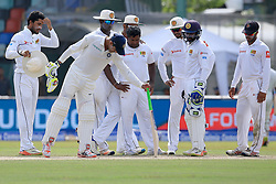 August 4, 2017 - Colombo, Sri Lanka - Sri Lankan cricket team players inspect a spot in the pitch that misbehaved  with uneven bounce as Indian cricketer ..Ravindra Jadeja joins in during the 2nd Day's play in the 2nd Test match between Sri Lanka and India at the SSC international cricket stadium at the capital city of Colombo, Sri Lanka on Friday 04 August 2017. (Credit Image: © Tharaka Basnayaka/NurPhoto via ZUMA Press)