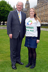 © Licensed to London News Pictures. 14/05/2013. Westminster, UK Nick Harvey MP, Elena Lilley. Patients campaigning for a life-saving treatment to be made available for all sufferers of the rare blood disease atypical Haemolytic Uraemic Syndrome (aHUS) present an urgent petition with over 30,000 signatures to MPs at the House of Commons on Tuesday May 14 2013... Photo credit : Stephen Simpson/LNP