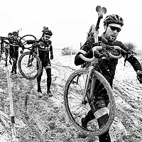 A group of Cyclocross riders navigate the sand during a snowstorm at the Illinois Cyclocross Championships in Chicago