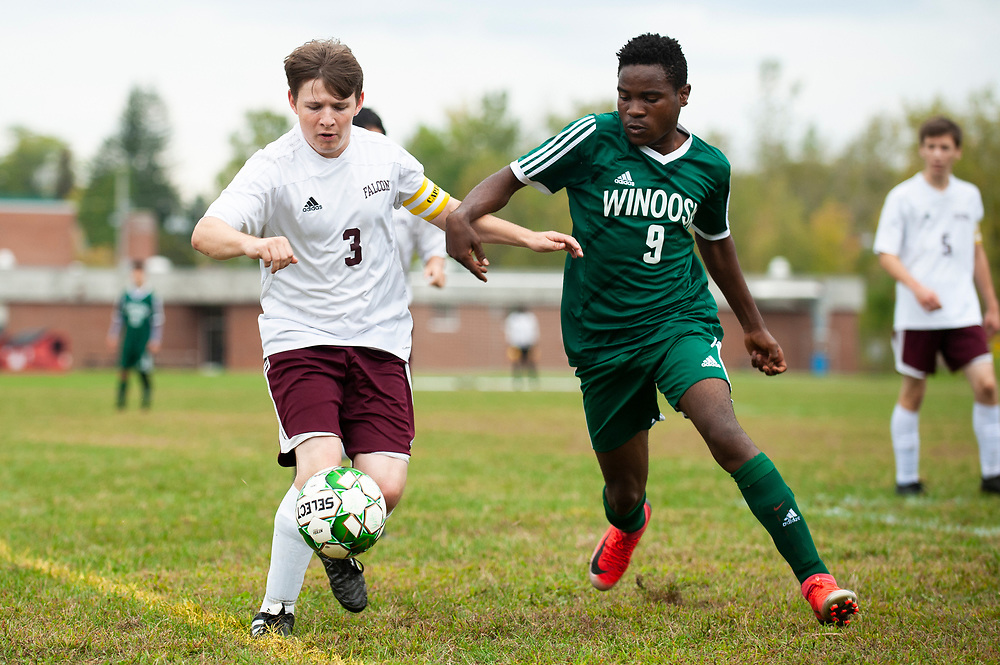 Winooski's Albert Busimba (9) and Richford's Gabriel Lagasse (3) battle for the ball during the boys soccer game between the Richard Eagles and the Winooski Spartans at Winooski High School on Saturday afternoon September 28, 2019 in Winooski, Vermont. (BRIAN JENKINS/for the FREE PRESS)