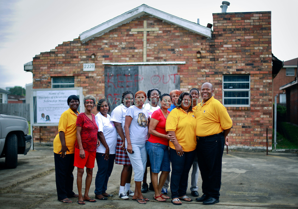 27 August 2014. Lower 9th Ward, New Orleans, Louisiana.<br /> Hurricane Katrina 9 years later. Disciples of Christ Christian Fellowship led by Pastor Darrell Turner arrive at a derelict church they have just closed on. Bringing hope to the neighborhood still struggling to recover from hurricane Katrina, Pastor Turner hopes to have the renovations completed within a year, ready for the 10th anniversary of the storm. <br /> Photo; Charlie Varley/varleypix.com