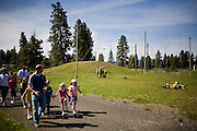 Chris Niccoli guides a group of tourists through the training area at the McCall Smoke Jumper Base. In 2009, about 5,600 people visited the McCall Smokejumper Base, which offers several guided tours per week.