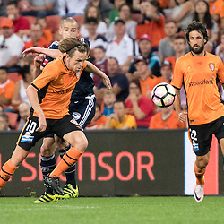 BRISBANE, AUSTRALIA - OCTOBER 7: Brett Holman of the Roar and Carl Valeri of the Victory compete for the ball during the round 1 Hyundai A-League match between the Brisbane Roar and Melbourne Victory at Suncorp Stadium on October 7, 2016 in Brisbane, Australia. (Photo by Patrick Kearney/Brisbane Roar)