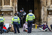 Extinction Rebellion activists glued themselves in front of the Peers Gate, outside Westminster Palace of the Houses of Parliament on Thursday, Sept 3, 2020. Environmental non-violent activists group Extinction Rebellion enters its 3rd day of continuous ten days to disrupt political institutions throughout peaceful actions swarming central London into a standoff, demanding that central government obeys and delivers Climate Emergency bill.
