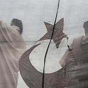 Two immams celebrate the great Friday prayer in the main square of Benghazi shortly after the first movements of protest that inflamed the country. Benghazi on March 4, 2011. Photograph Arnaud Finistre / Hans Lucas<br /> Deux immams celebrent la grande priere du vendredi sur la place principale de Benghazi peu de temps apres les premiers mouvements de contestation qui ont enflamme le pays. Benghazi le 4 mars 2011. Photographie Arnaud Finistre / Hans Lucas