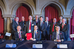 © Licensed to London News Pictures . 03/11/2014 . Manchester , UK . Front L-R Sir Richard Leese , The Chancellor of the Exchequer , George Osborne MP and Lord Peter Smtih at Manchester Town Hall signing a deal to devolve power to Greater Manchester , including giving the city a Mayor and greater control over its finances . Photo credit : Joel Goodman/LNP