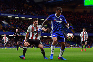 Ruben Loftus-Cheek of Chelsea (R) in action with Maxime Colin of Brentford (L). The Emirates FA Cup 4th round match, Chelsea v Brentford at Stamford Bridge in London on Saturday 28th January 2017.<br /> pic by Steffan Bowen, Andrew Orchard sports photography.