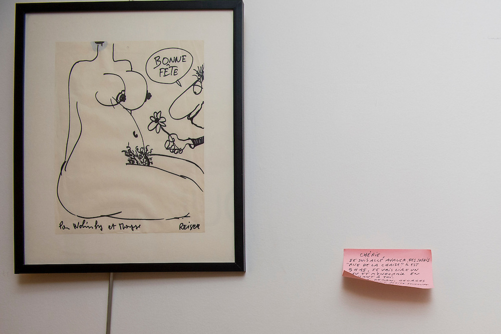"""March 6, 2015, Paris, France. Post-it notes decorate the Paris' apartment where Georges and Maryse Wolinski used to live. French Cartoonist Georges Wolinski (1934 –2015) wrote daily post-it notes to his wife Maryse Wolinski (1943, Algiers). Two month after the death of Georges Wolinski, the apartment is full of souvenirs and notes, attesting a half-century-long love relation: """": """"Darling, I went to eat Sushis in the Rue de la Chaise, it is 9.15 PM, I will read a little and sleep, while thinking about you."""" Georges."""" <br /> The cartoonist Georges Wolinski was 80 years old when he was murdered by the French jihadists Chérif en Saïd Kouachi, he was one of the 12  victims of the massacre in the Charlie Hebdo offices on January 7, 2015 in Paris. Charlie Hebdo published caricatures of Mohammed, considered blasphemous by some Muslims. During his life, Georges Wolinski defended freedom, secularism and humour and was one of the major political cartoonists in France. The couple was married and had lived for 47 years together. Photo: Steven Wassenaar."""