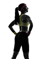 one woman exercising fitness workout rear view standing in silhouette on white background