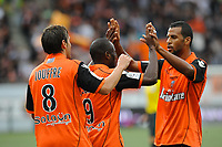 FOOTBALL - FRENCH CHAMPIONSHIP 2011/2012 - L1 - FC LORIENT v AJ AUXERRE - 21/09/2011 - PHOTO PASCAL ALLEE / DPPI - JOY INNOCENT NKASIOBI EMEGHARA (FCL) AFTER HIS GOAL. HE IS CONGRATULATED BY YANN JOUFFRE (L) AND JACQUES ALAIXYS ROMAO (R)