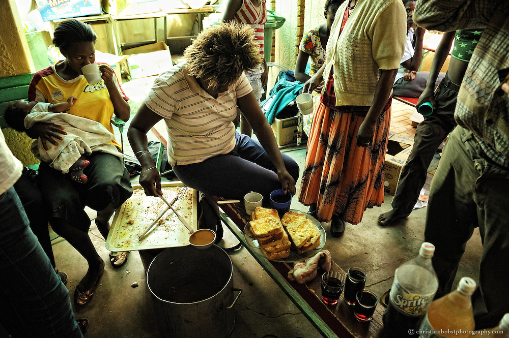 (2008) The women get some food and drinks at father Hermanns shelter. Many of them come there because they and their children have nothing to eat.