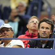 2017 U.S. Open Tennis Tournament - DAY TWO. Uncle Toni Nadal and coach Carlos Moya watching Rafael Nadalof Spain in action against DusanLajovic of Serbia during the Men's Singles round one match at the US Open Tennis Tournament at the USTA Billie Jean King National Tennis Center on August 29, 2017 in Flushing, Queens, New York City.  (Photo by Tim Clayton/Corbis via Getty Images)