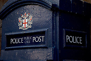 Old fashioned blue Police telephone box in the City of London.