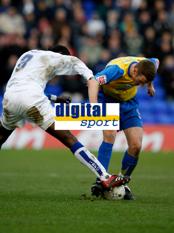 Photo: Paul Greenwood.<br />Tranmere Rovers v Hereford City. FA Cup Third Round. 05/01/2008. <br />Hereford's Lee collins (R) is tackled by Calvin Zola