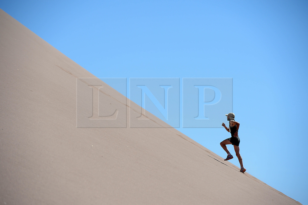 © Licensed to London News Pictures. 10/11/2014. London, England. . Photo credit : Mike King/LNP<br /> Runners train ahead of the Volcano Marathon, to be held in the Atacama Desert, Chile 11/11/2014<br /> Gary Thornton, Ireland.