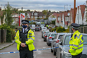 Police guard a crime scene entry by the Dale Close Road, in Barnet, North London on Wednesday, Sept 23, 2020, after several police officers have been injured by a chemical substance while carrying out a drugs raid in north London. (VXP Photo/ Vudi Xhymshiti)