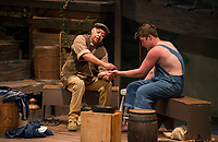 Angel Douglas as Jim tells Huck Finn played by Riley Alward about his life lines while they sit on the raft during dress rehearsal for Big River with the Streetcar Company at the Interlakes High School Auditorium on Tuesday evening.   (Karen Bobotas/for the Laconia Daily Sun)