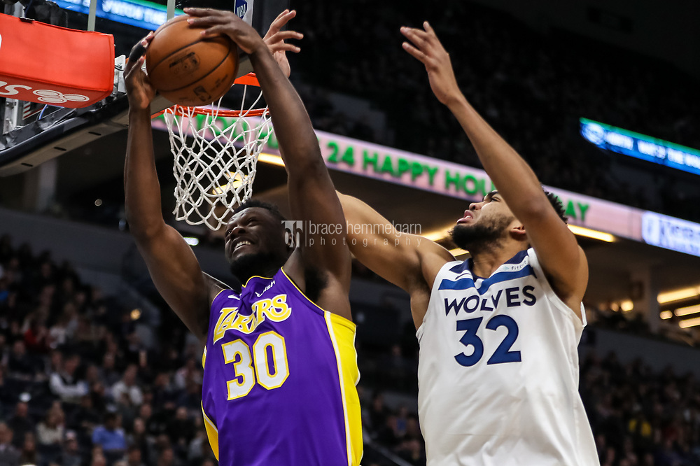 Feb 15, 2018; Minneapolis, MN, USA; Los Angeles Lakers forward Julius Randle (30) grabs a rebound over Minnesota Timberwolves center Karl-Anthony Towns (32) during the second quarter at Target Center. Mandatory Credit: Brace Hemmelgarn-USA TODAY Sports