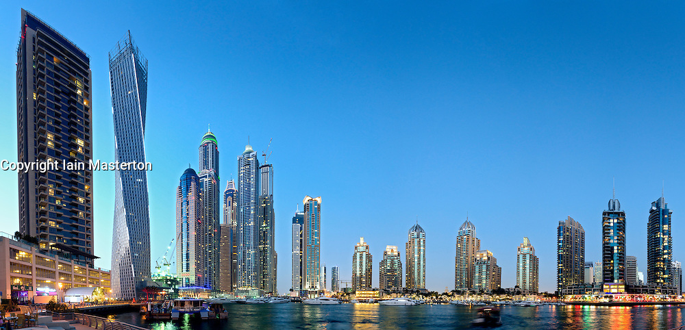 Many modern skyscrapers at dusk at Marina district in Dubai United Arab Emirates