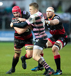 Dragons' Cory Hill under pressure from Cardiff Blues' Gareth Anscombe<br /> <br /> Photographer Simon King/Replay Images<br /> <br /> Guinness Pro14 Round 11 - Dragons v Cardiff Blues - Tuesday 26th December 2017 - Rodney Parade - Newport<br /> <br /> World Copyright © 2017 Replay Images. All rights reserved. info@replayimages.co.uk - www.replayimages.co.uk