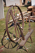 Old spinning wheel at auction during the Annual Mud Sale to support the Fire Department  in Gordonville, PA.
