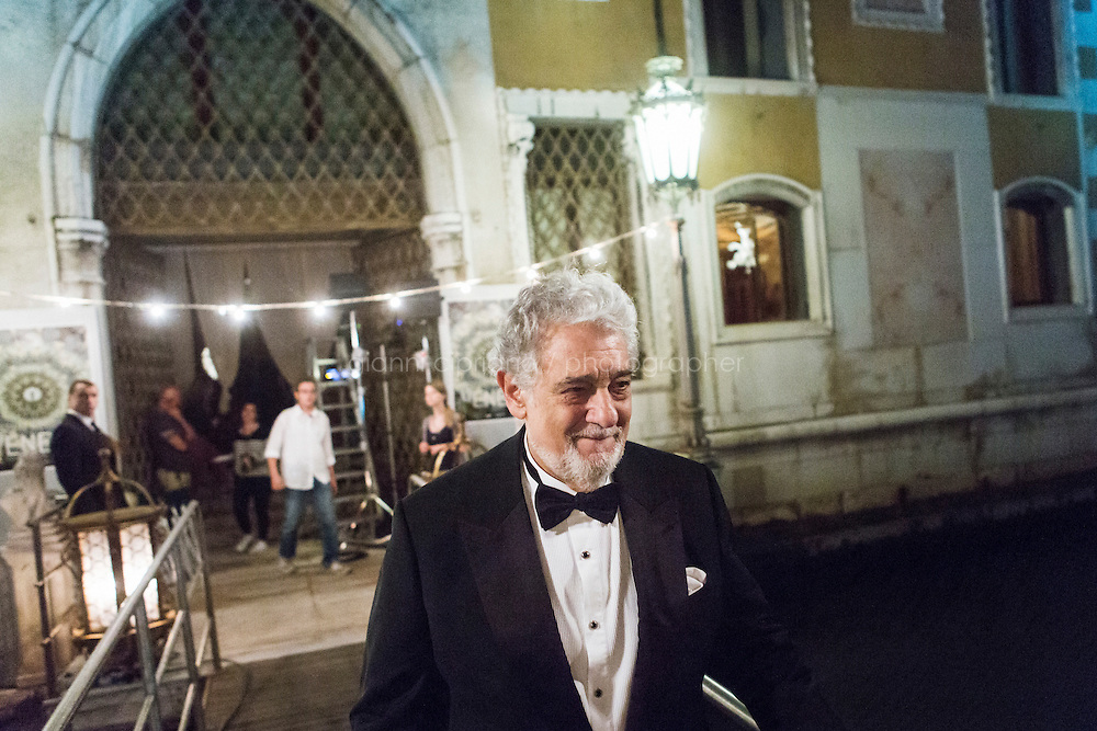 """VENICE, ITALY - 13 JULY 2016: Tenor and conductor Placido Domingo (75) steps out of Palazzo Cavalli-Franchetti to shoot a scene of the third season of """"Mozart in the Jungle"""" in which he will interpret himself in Venice, Italy, on July 13th 2016.<br /> <br /> Mozart in the Jungle is an award-winning television series produced by Picrow for Amazon Studios. The pilot was written by Roman Coppola, Jason Schwartzman, and Alex Timbers and directed by Paul Weitz. The story was inspired by Mozart in the Jungle: Sex, Drugs, and Classical Music, oboist Blair Tindall's 2005 memoir of her professional career in New York."""