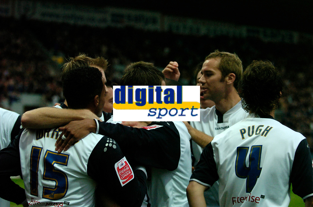Photo: Paul Greenwood.<br />Preston North End v Luton Town. Coca Cola Championship. 04/11/2006. PNE players mob captain Graham Alexander after he scores the first goal.