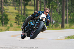 Roland Sands rides his custom Indian Chieftan up Vanocker Canyon during the Annual Sturgis Black Hills Motorcycle Rally. SD, USA. August 4, 2014.  Photography ©2014 Michael Lichter.
