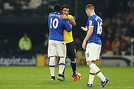 Romelu Lukaku of Everton hugs Troy Deeney, the Watford captain .Premier league match, Watford v Everton at Vicarage Road in Watford, London on Saturday 10th December 2016.<br /> pic by John Patrick Fletcher, Andrew Orchard sports photography.