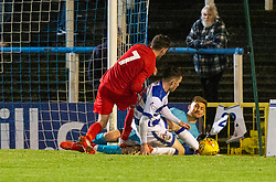 Morton's keeper Danny Rogers saves from Brora Rangers Tom Kelly. Morton 1 v 1 Brora Rangers, 3rd Round of the Scottish Cup played 23/11/2019 at Cappielow, Greenock.