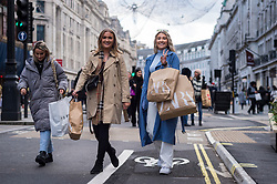 © Licensed to London News Pictures. 05/12/2020. LONDON, UK.  Shoppers in Regent Street on the first Saturday after lockdown restrictions were lifted on 2 December.  Retailers are hoping that physical sales will pick up in the run up to Christmas.  This comes against a backdrop of two major retailers Debenhams and Arcadia, owner of Topshop, collapsing into administration in the last week.  Photo credit: Stephen Chung/LNP