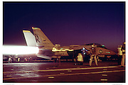 F-14 in full afterburner on aircraft carrier deck