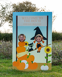 Kilduff Farm, East Lothian, Scotland, United Kingdom, 17 October 2019. Pumpkin Patch: The pick your own pumpkin patch gears up for its opening tomorrow. In its second year, Lucy and Russell Calder and their daughters make final preparations for visitors. The patch is open this weekend and next, selling a variety of Halloween carving pumpkins and culinary pumpkins. Pictured: Maisie (10 years) and Louisa (8 years).<br /> Sally Anderson | EdinburghElitemedia.co.uk