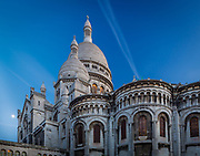 The Basilica of the Sacred Heart of Paris, commonly known as Sacré-Cœur Basilica (French: Basilique du Sacré-Cœur), is a Roman Catholic church and minor basilica, dedicated to the Sacred Heart of Jesus, in Paris, France. A popular landmark, the basilica is located at the summit of the butte Montmartre, the highest point in the city. Sacré-Cœur is a double monument, political and cultural, both a national penance for the supposed excesses of the Second Empire and socialist Paris Commune of 1871 crowning its most rebellious neighborhood, and an embodiment of conservative moral order, publicly dedicated to the Sacred Heart of Jesus, which was an increasingly popular vision of a loving and sympathetic Christ.