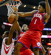 Dec 19, 2012; Houston, TX, USA; Philadelphia 76ers shooting guard Nick Young (1) blocks a shot by Houston Rockets point guard Toney Douglas (15) during the fourth quarter at the Toyota Center. The Rockets won 125-103. Mandatory Credit: Thomas Campbell-USA TODAY Sports