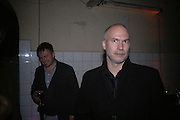 Stuart Shave and Claus Biesenbach. Frieze Party Berlin. Stadtbad, Oderberger Strasse 57-59, Oderberger Strasse. Berlin. 23 March 2006. ONE TIME USE ONLY - DO NOT ARCHIVE  © Copyright Photograph by Dafydd Jones 66 Stockwell Park Rd. London SW9 0DA Tel 020 7733 0108 www.dafjones.com