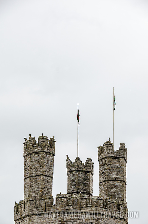 Some of the distinctive parapets against clouds at Caernarfon Castle in northwest Wales. A castle originally stood on the site dating back to the late 11th century, but in the late 13th century King Edward I commissioned a new structure that stands to this day. It has distinctive towers and is one of the best preserved of the series of castles Edward I commissioned.