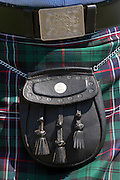Traditional Highland Dress clan tartan kilt with sporran worn in the Highlands of Scotland. Much debate precedes the 2014 Scottish Independence Referendum.