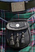 Traditional Highland Dress clan tartan kilt with sporran worn in the Highlands of Scotland. Much debate precedes the 2014 Scottish Independence Referendum.
