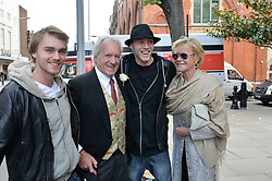 JOHN RENDALL, his former wife MELANIE RENDALL and their sons MAX RENDALL and NICKY RENDALL (wearing hat) at the wedding of Pattie Boyd & Rod Weston  at Chelsea Registry Office, Chelsea Old Town Hall, King's Road, London on 30th April 2015. Pattie Boyd was previously married to both George Harrison and Eric Clapton.