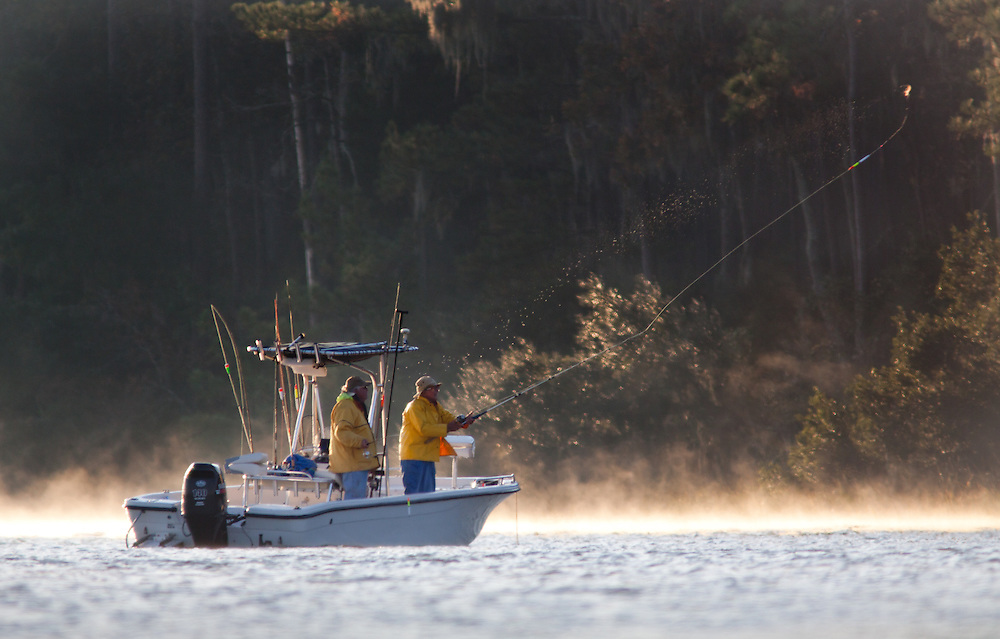 Boaters begin fishing in the fall morning mist along the May River.