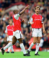 Sylvian Wiltord celebrates scoring his and Arsenals 1st goal with captain Tony Adams. Arsenal 2:1 Coventry City, F.A. Carling Premiership, 16/9/2000. Credit: Colorsport / Stuart MacFarlane.