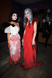 Left to right, stylist HANNAH BHUIYA and jeweller LARA BOHINC at the 3rd annual Browns Focus Halloween Party held at the Shepherd's Bush Pavilion, London W12 on 30th October 2009.