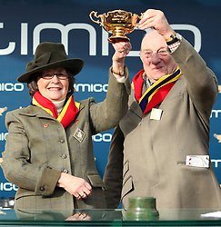Owners Anne and Garth Broom lift the trophy after their horse Native River wins the Timico Cheltenham Gold Cup during Gold Cup Day of the 2018 Cheltenham Festival at Cheltenham Racecourse.