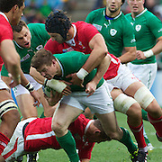 """Brian O""""Driscoll, Ireland, is tackled by Luke Charteris, Wales, during the Ireland V Wales Quarter Final match at the IRB Rugby World Cup tournament. Wellington Regional Stadium, Wellington, New Zealand, 8th October 2011. Photo Tim Clayton..."""