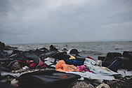 Life jackets, a baby blanket, and the remains of an inflatable boat are strewn on a beach near Mytilene on the Greek island of Lesbos, remnants of the journey from Turkey that hundreds of thousands of Europe-bound migrants have made in 2015. The turkish coast is faintly visible on the horizon. (October 23, 2015)