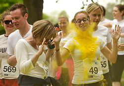 © Licensed to London News Pictures. 19/05/2013. Bristol, UK. Rainbow Run for Children's Hospice South West on the Bristol Downs.  Runners start out clean and have multi-colour paint thrown on them, running in aid of CHSW's Charlton Farm hospice, one of three hospices in the South West dedicated to making the most of short and precious lives.  19 May 2013..Photo credit : Simon Chapman/LNP