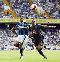 Photo: Chris Ratcliffe.<br /> Tottenham Hotspur v Inter Milan. Pre Season Friendly. 28/07/2006.<br /> Wayne Routledge of Spurs (R) tssles with Rodriguez Cesar of Inter
