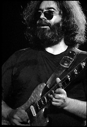 Jerry Garcia looking out over the Audience in Contemplation. The Grateful Dead in Concert at the Huntington Civic Center, Huntington West Virginia on 16 April 1978. Image No. 78C15-07M